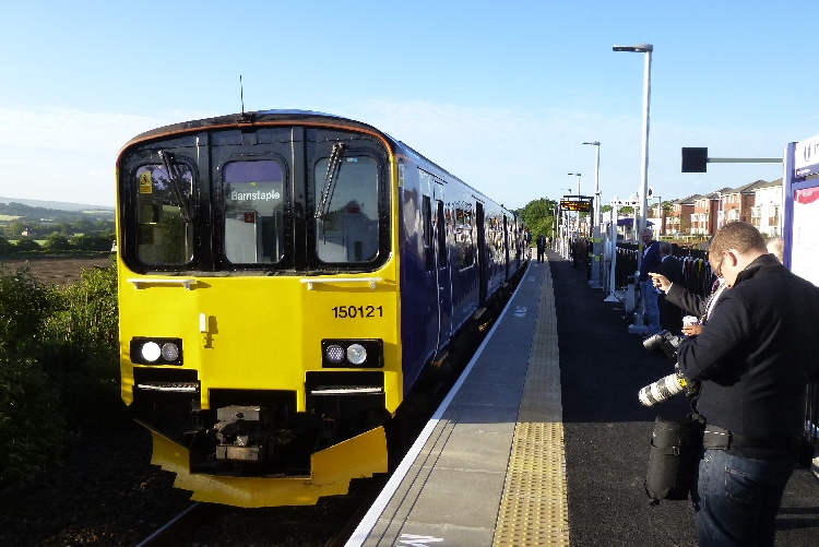 Newcaurt station in Exeter opened on 4 June 2015. This photo shows a Class 150 train waiting at the single-platform station.