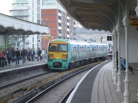 Passengers depart from a Class 456 train at Battersea Park station