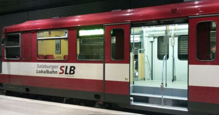 Photo of one of the older Lokalbahn trains waiting for passengers to board in the underground platform at Salzburg Hauptbahnhof station