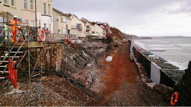 Cropped photo (taken on 15/02/2014) of the destruction of the sea wall at Dawlish, which caused the railway t be closed for two months